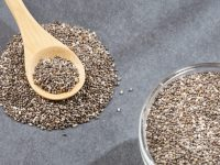 Organic chia seeds in the wooden spoon - Salvia hispanica